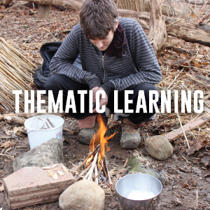 Student making fire using primitive techniques.