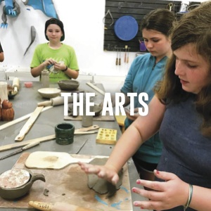 students making clay vessels