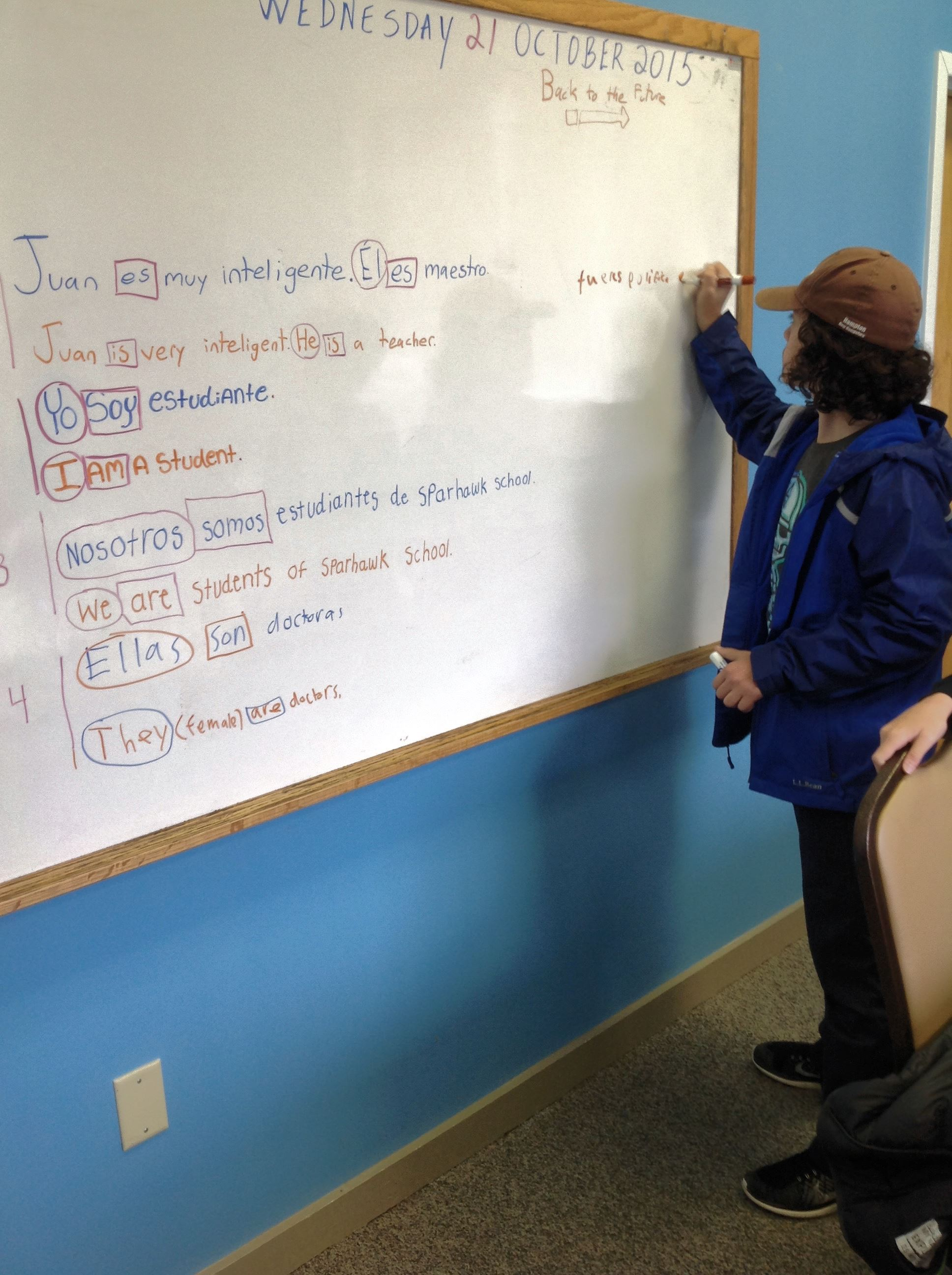 Sparhawk middle school student standing at a white board completing a lesson