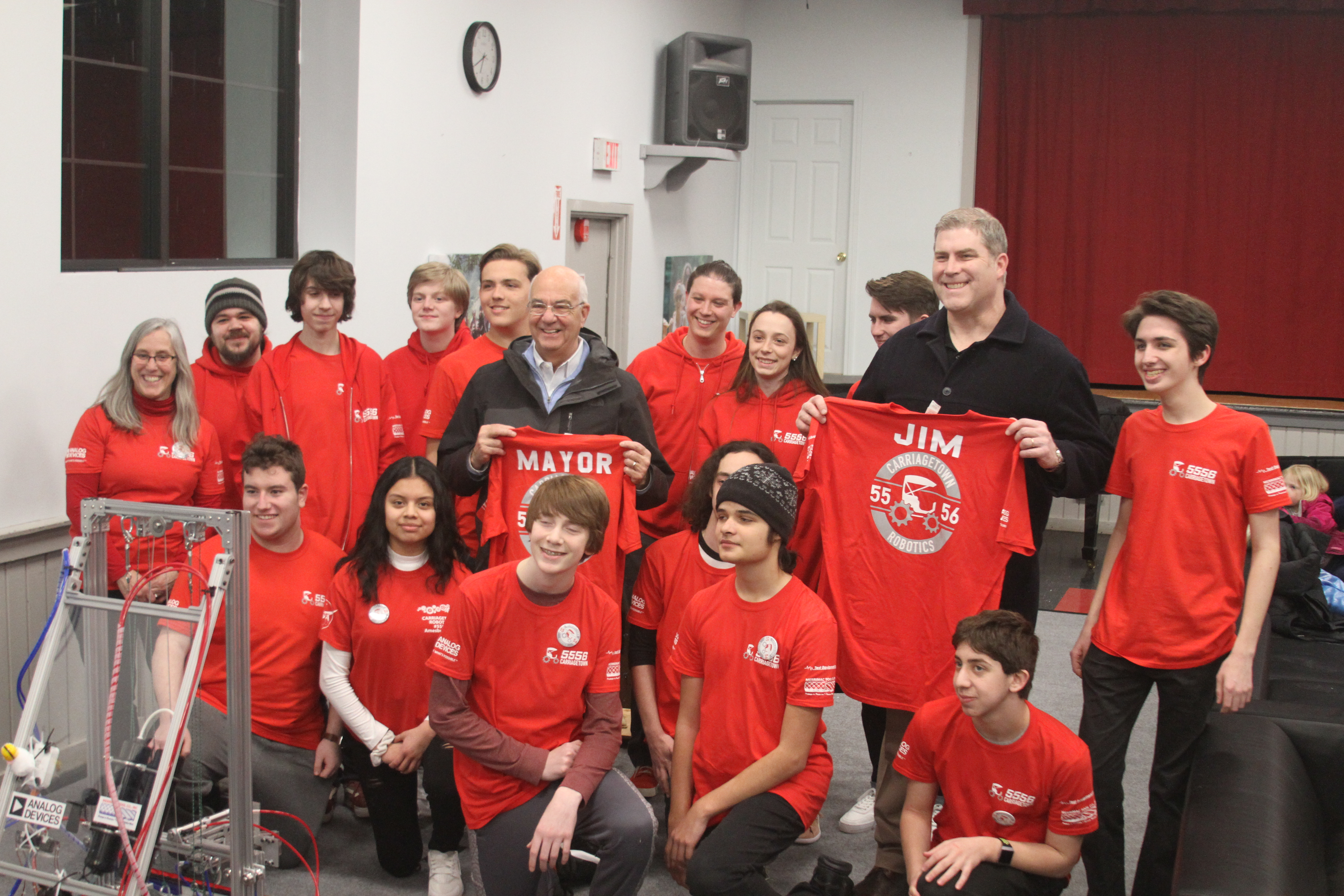 Sparhawk FIRST robotics team posing for a photo with State Senator, James Kelcourse.